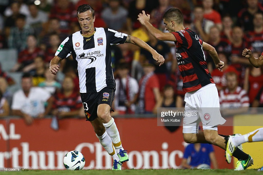 Ryan Griffiths of the Jets runs the ball during the round 20 A-League match between the Western Sydney Wanderers and the Newcastle Jets at Campbelltown Sports Stadium on February 9, 2013 in Sydney, Australia.