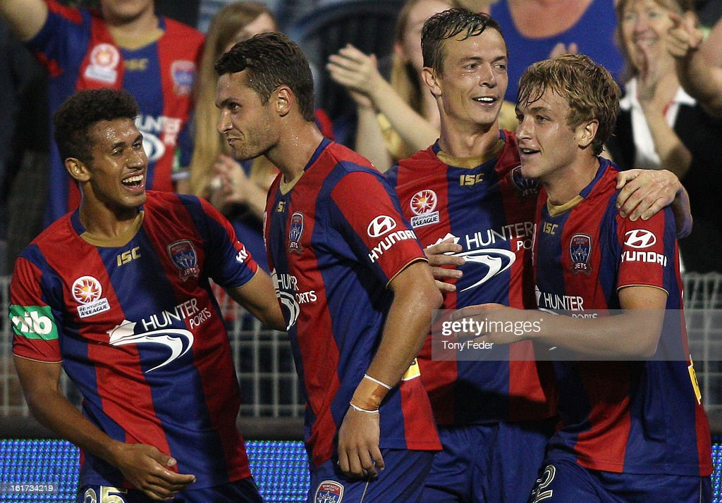 Ryan Griffiths of the Newcastle Jets celebrates a goal with his team mates during the round 21 ALeague match between the Newcastle Jets and the...