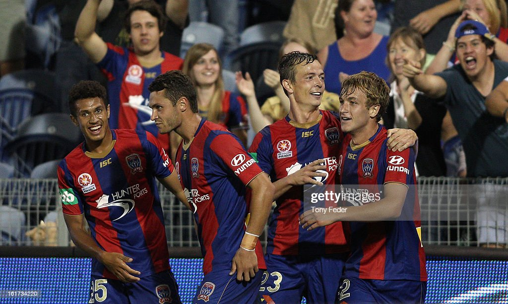 Ryan Griffiths of the Newcastle Jets celebrates a goal with teammates during the round 21 ALeague match between the Newcastle Jets and the Melbourne...