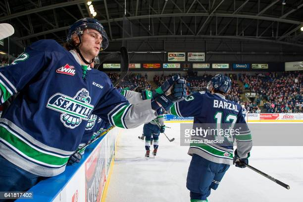 Ryan Gropp fist pumps Mathew Barzal of the Seattle Thunderbirds from the bench to celebrate a goal against the Kelowna Rockets on February 13 2017 at...
