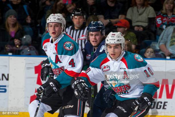 Ryan Gropp of the Seattle Thunderbirds back checks Gordie Ballhorn and Nick Merkley of the Kelowna Rockets on February 13 2017 at Prospera Place in...