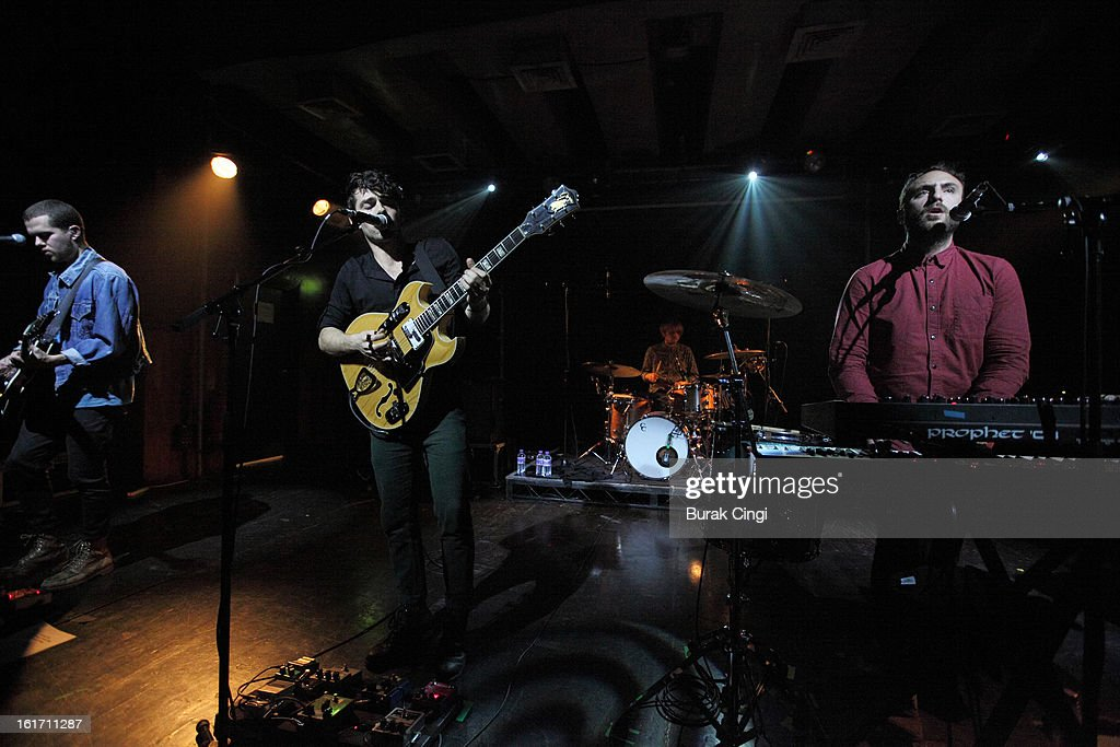 Ryan Hahn, Taylor Rice and Kelsey Ayer Local Natives perform on stage at Scala on February 14, 2013 in London, England.