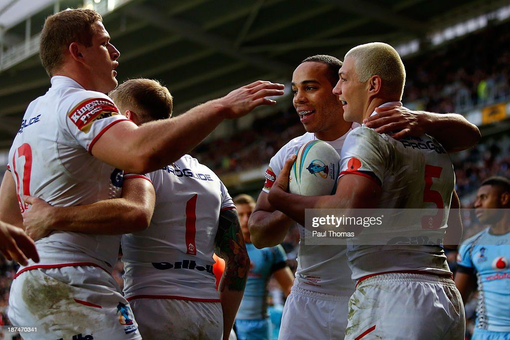 Ryan Hall (R) of England celebrates his second try with team mates George Burgess (L) and Leroy Cudjoe during the Rugby League World Cup Group A match at the KC Stadium on November 9, 2013 in Hull, England.