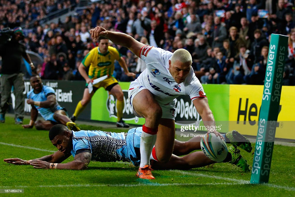 Ryan Hall of England dives over to score a try during the Rugby League World Cup Group A match at the KC Stadium on November 9, 2013 in Hull, England.