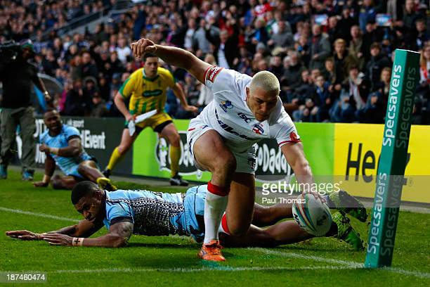 Ryan Hall of England dives over to score a try during the Rugby League World Cup Group A match at the KC Stadium on November 9 2013 in Hull England