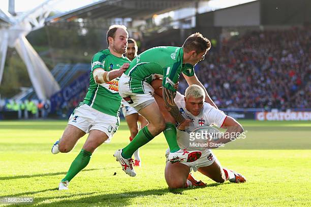 Ryan Hall of England heads for his third try as James Mendeika and Liam Finn fail to stop him of Ireland during the Rugby League World Cup Group A...