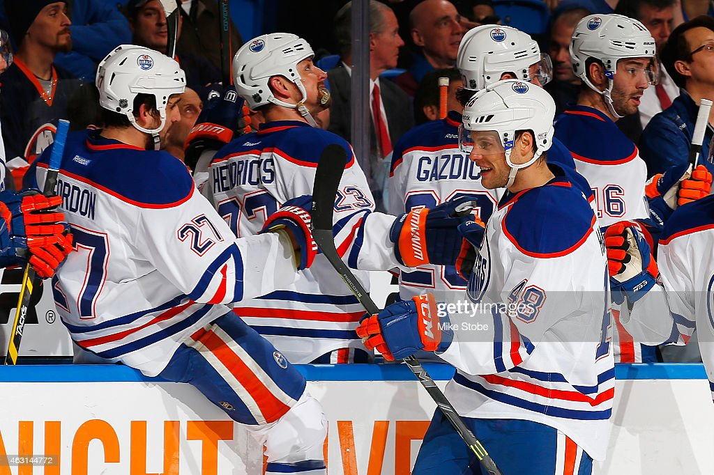 Ryan Hamilton #48 of the Edmonton Oilers is congratulated by his teammates after scoring his first career NHL goal against the New York Islanders at Nassau Veterans Memorial Coliseum on February 10, 2015 in Uniondale, New York.