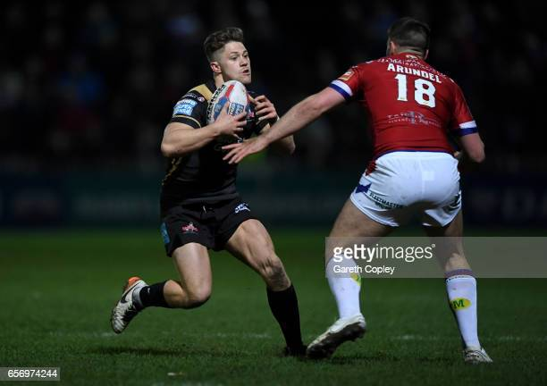 Ryan Hampshire of Leigh is tackled by Joe Arundel of Wakefield during the Betfred Super League match between Wakefield Trinity and Leigh Centurions...