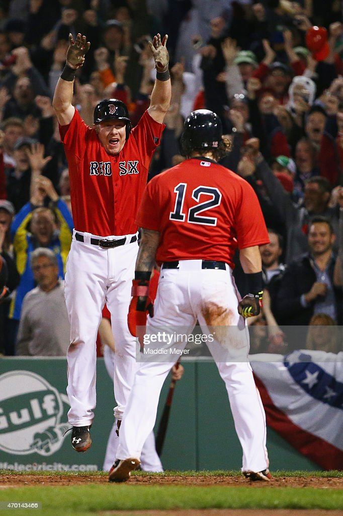 Ryan Hanigan celebrates as Mike Napoli of the Boston Red Sox scores the game winning run against the Baltimore Orioles during the ninth inning at...