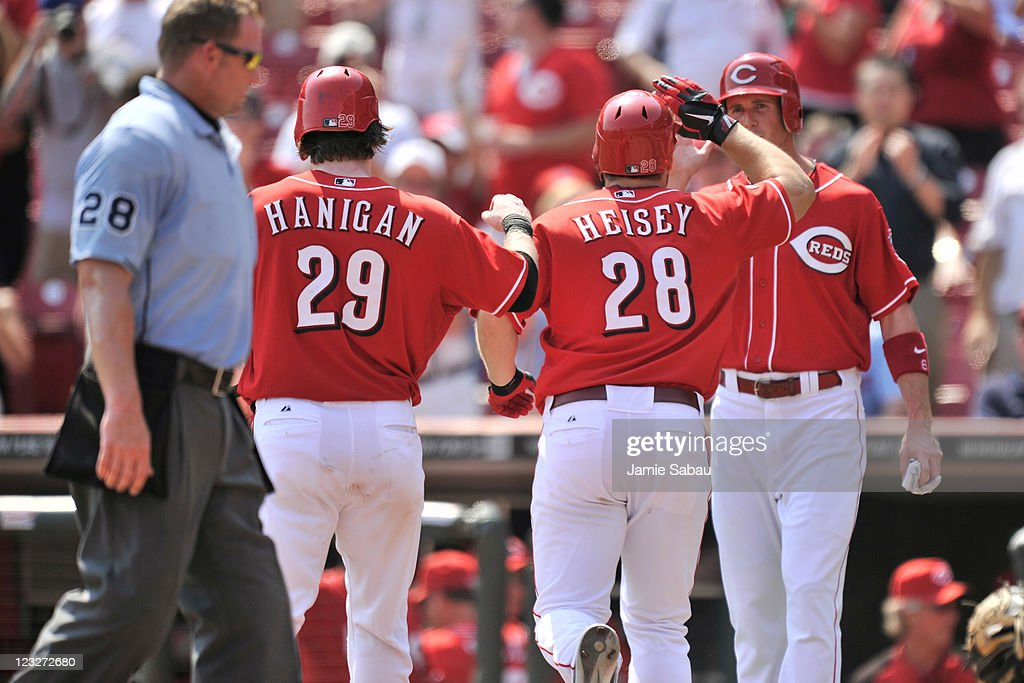 Ryan Hanigan #29, Chris Heisey #28 and Drew Stubbs #6 of the Cincinnati Reds celebrate Heisey's three-run home run against the Philadelphia Phillies at Great American Ball Park on September 1, 2011 in Cincinnati, Ohio. Philadelphia completed the series sweep with a 6-4 win over Cincinnati.