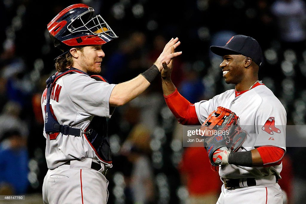 Ryan Hanigan #10 of the Boston Red Sox (L) and Rusney Castillo #38 of the Boston Red Sox high five after defeating the Chicago White Sox at U.S. Cellular Field on August 24, 2015 in Chicago, Illinois. The Boston Red Sox on 5-4.