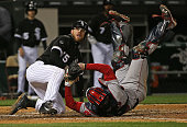 Ryan Hanigan of the Boston Red Sox ends up on his back after tagging out Brett Lawrie of the Chicago White Sox to end the 5th inning at US Cellular...