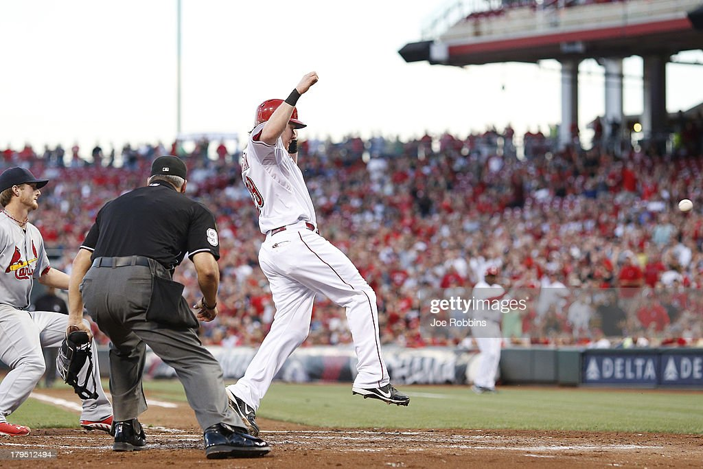<a gi-track='captionPersonalityLinkClicked' href=/galleries/search?phrase=Ryan+Hanigan&family=editorial&specificpeople=833982 ng-click='$event.stopPropagation()'>Ryan Hanigan</a> #29 of the Cincinnati Reds scores a run on a wild pitch in the second inning of the game against the St. Louis Cardinals at Great American Ball Park on September 4, 2013 in Cincinnati, Ohio.