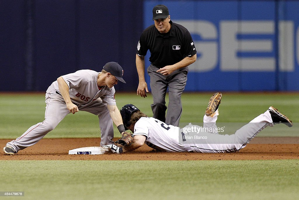 Ryan Hanigan #24 of the Tampa Bay Rays slides safely into second base ahead of the tag by second baseman Brock Holt #26 of the Boston Red Sox during the 10th inning of a game on September 1, 2014 at Tropicana Field in St. Petersburg, Florida.