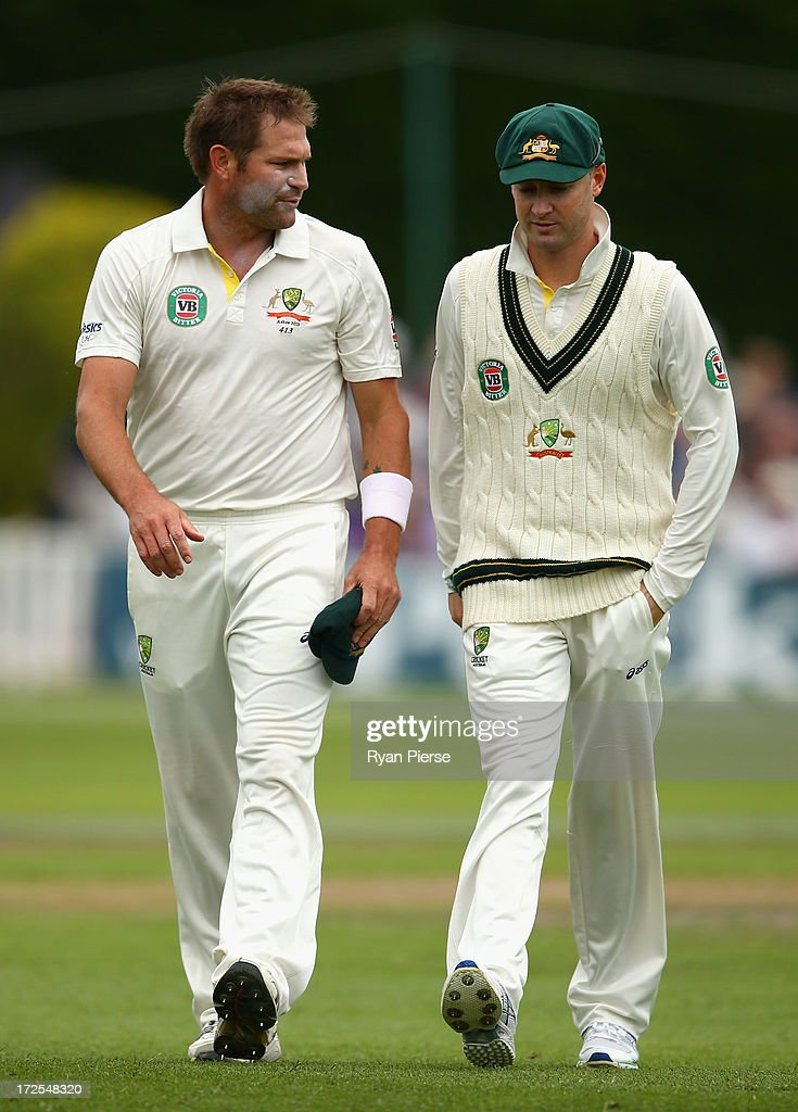 Ryan Harris and Michael Clarke of Australia talk tactics during day two of the Tour Match between Worcestershire and Australia at New Road at New Road on July 3, 2013 in Worcester, England.