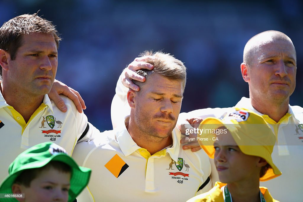 Ryan Harris, <a gi-track='captionPersonalityLinkClicked' href=/galleries/search?phrase=David+Warner+-+Cricketer&family=editorial&specificpeople=4262255 ng-click='$event.stopPropagation()'>David Warner</a> and <a gi-track='captionPersonalityLinkClicked' href=/galleries/search?phrase=Brad+Haddin&family=editorial&specificpeople=193800 ng-click='$event.stopPropagation()'>Brad Haddin</a> of Australia react during the tribute to Phillip Hughes during day one of the First Test match between Australia and India at Adelaide Oval on December 9, 2014 in Adelaide, Australia.