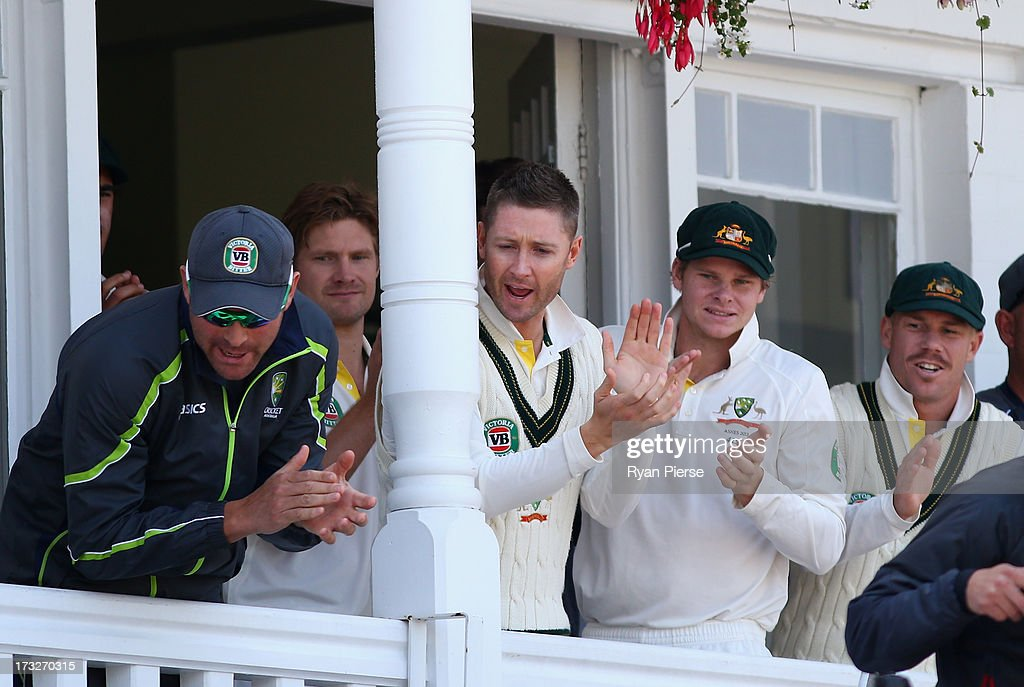 Ryan Harris, Michael Clarke, Steve Smith and David Warner of Australia clap their batsmen Ashton Agar and Phil Hughes of Australia from the ground at the lunch break during day two of the 1st Investec Ashes Test match between England and Australia at Trent Bridge Cricket Ground on July 11, 2013 in Nottingham, England.