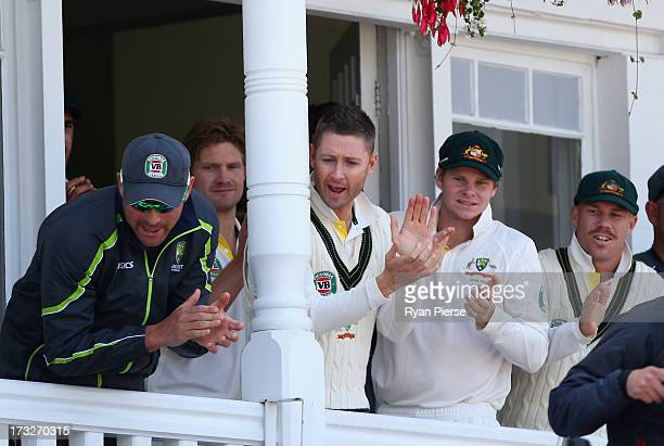 Ryan Harris Michael Clarke Steve Smith and David Warner of Australia clap their batsmen Ashton Agar and Phil Hughes of Australia from the ground at...