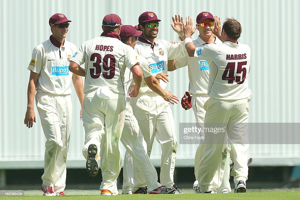 Ryan Harris of the Bulls celebrates with team mates after dismissing George Bailey of the Tigers for a duck during day one of the Sheffield Shield match between the Queensland Bulls and the Tasmanian Tigers at The Gabba on March 7, 2013 in Brisbane, Australia.