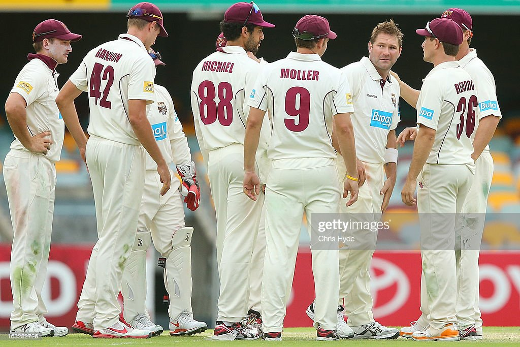 Ryan Harris of the Bulls celebrates with team mates after dismissing James Faulkner of the Tigers during day one of the Sheffield Shield match between the Queensland Bulls and the Tasmanian Tigers at The Gabba on March 7, 2013 in Brisbane, Australia.