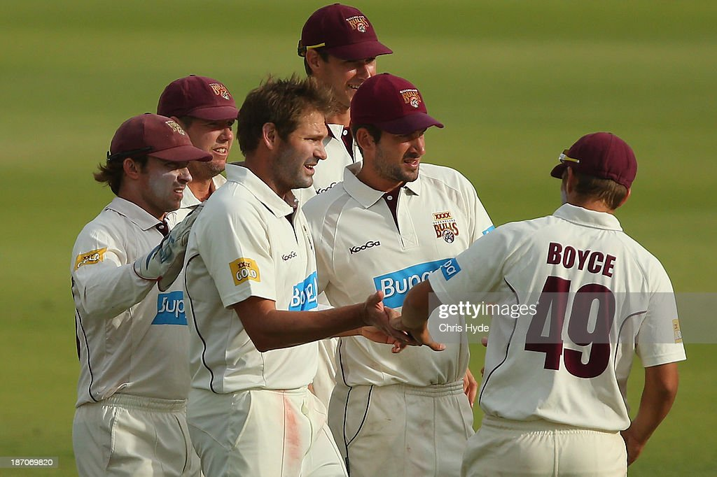 Ryan Harris of the Bulls celebrates with team mates after dismissing Jordan Silk of the Tigers during day one of the Sheffield Shield match between the Queensland Bulls and the Tasmania Tigers at Allan Border Field on November 6, 2013 in Brisbane, Australia.