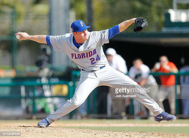 Ryan Harris of the Florida Gators throws the ball against the Miami Hurricanes during the seventh inning on February 23 2014 at Alex Rodriguez Park...