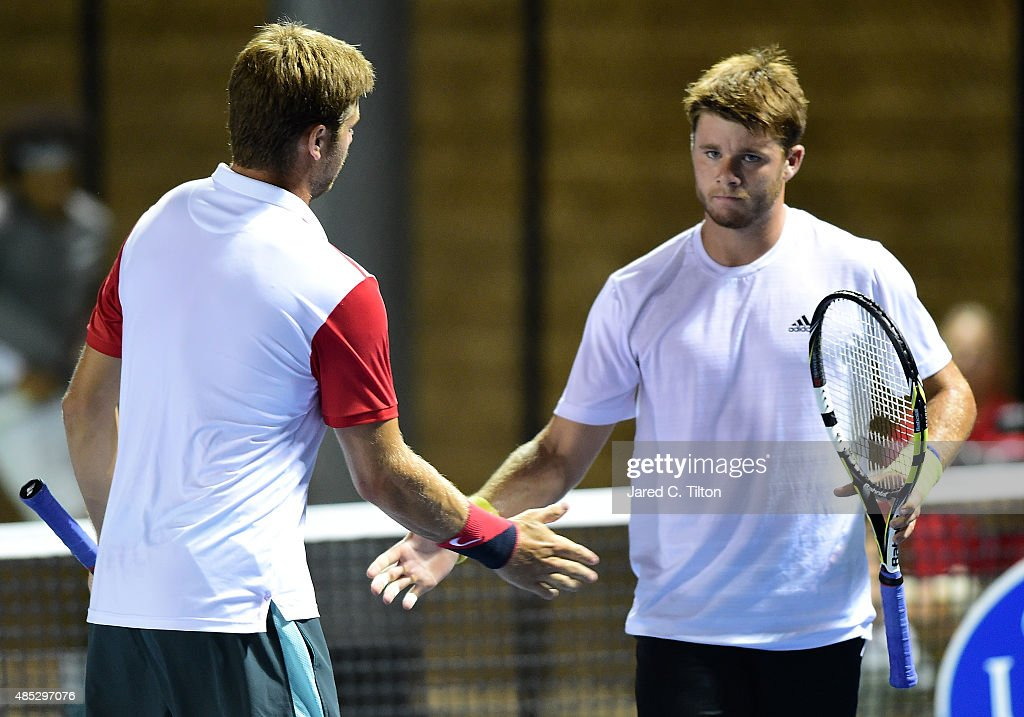 Ryan Harrison (left) and Christian Harrison react after a point against Skander Mansouri of Tunisia and Christian Seraphim of Germany during the third day of the Winston-Salem Open at Wake Forest University on August 26, 2015 in Winston-Salem, North Carolina.