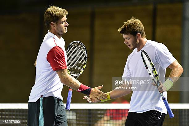 Ryan Harrison and Christian Harrison react after a point against Skander Mansouri of Tunisia and Christian Seraphim of Germany during the third day...