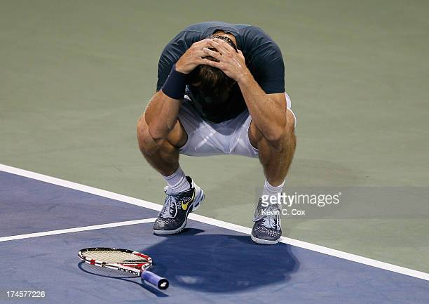 Ryan Harrison drops his racquet after a misplayed return to Kevin Anderson of South Africa during the BBT Atlanta Open in Atlantic Station on July 27...