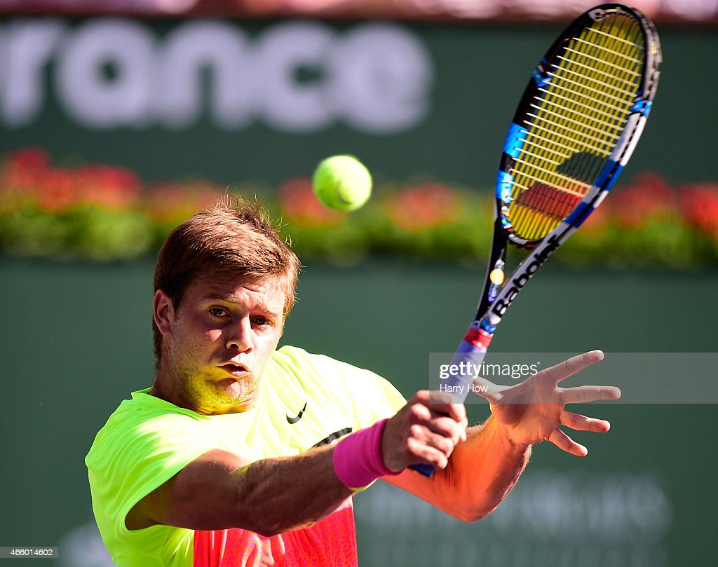 Ryan Harrison hits a backhand volley in his match against Mardy Fish during the BNP Parisbas Open at the Indian Wells Tennis Garden on March 12, 2015 in Indian Wells, California.