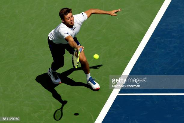 Ryan Harrison lunges for a shot while playing Gilles Muller of Luxembourg during the Western Southern Open at the Lindner Family Tennis Center on...