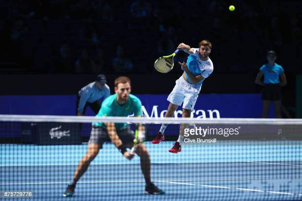 Ryan Harrison of the United States and Michael Venus of New Zealand in action in the Doubles Semi Final match against Lukasz Kubot of Poland and...
