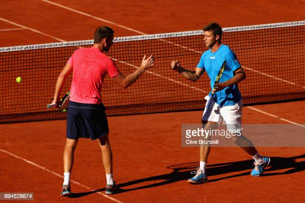 Ryan Harrison of The United States and partner Michael Venus of New Zealand speak during the mens doubles final match against Donald Young of The...