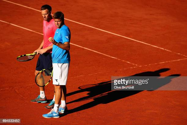 Ryan Harrison of The United States and partner Michael Venus of New Zealand speakl during the mens doubles final match against Donald Young of The...