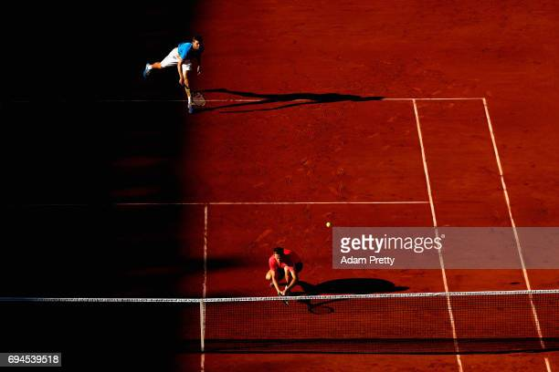Ryan Harrison of The United States and partner Michael Venus of New Zealand serve during the mens doubles final match against Donald Young of The...
