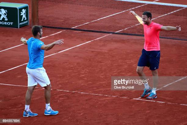 Ryan Harrison of The United States and partner Michael Venus of New Zealand celebrate victory in the mens doubles final match against Donald Young of...