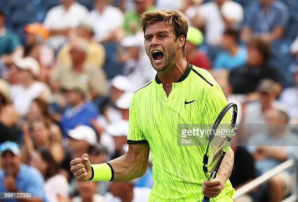 Ryan Harrison of the United States celebrates his win over Milos Raonic of Canada during his second round Men's Singles match on Day Three of the...