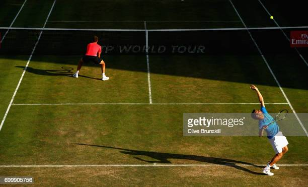 Ryan Harrison of The United States partner of Michael Venus of New Zealand returns the ball during the mens doubles match against Jamie Murray of...