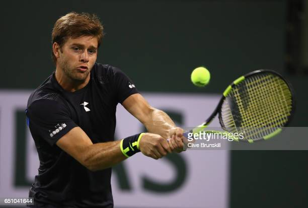 Ryan Harrison of the United States plays a backhand against Damir Dzumhur of Bosnia and Herzegovina in their first round match during day four of the...