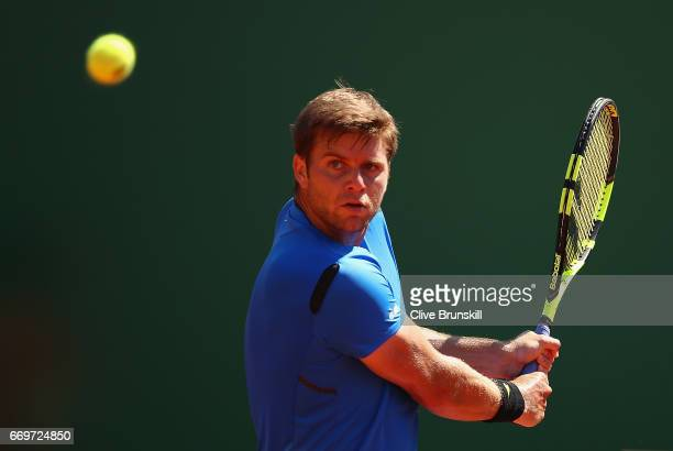 Ryan Harrison of the United States plays a backhand against Lucas Pouille of France in his first round match on day three of the Monte Carlo Rolex...