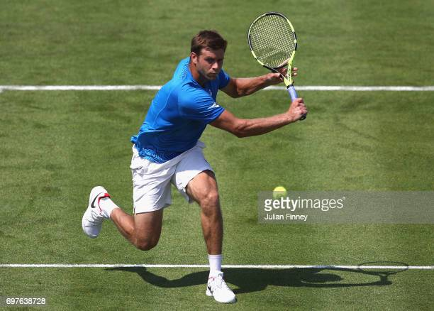 Ryan Harrison of The United States plays a backhand during the mens singles first round match against Grigor Dimitrov of Bulgaria during day one of...