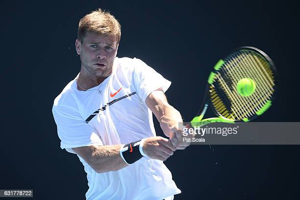 Ryan Harrison of the United States plays a backhand in his first round match against Nicolas Mahut of of Frances on day one of the 2017 Australian...