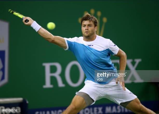 Ryan Harrison of the United States returns a shot during the Men's singles second round match against Grigor Dimitrov of Bulgaria on day four of 2017...