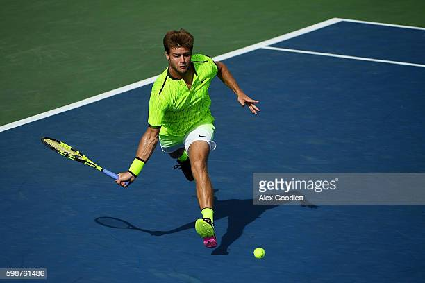 Ryan Harrison of the United States returns a shot to Marcos Baghdatis of Cyprus during his third round Men's Singles match on Day Five of the 2016 US...