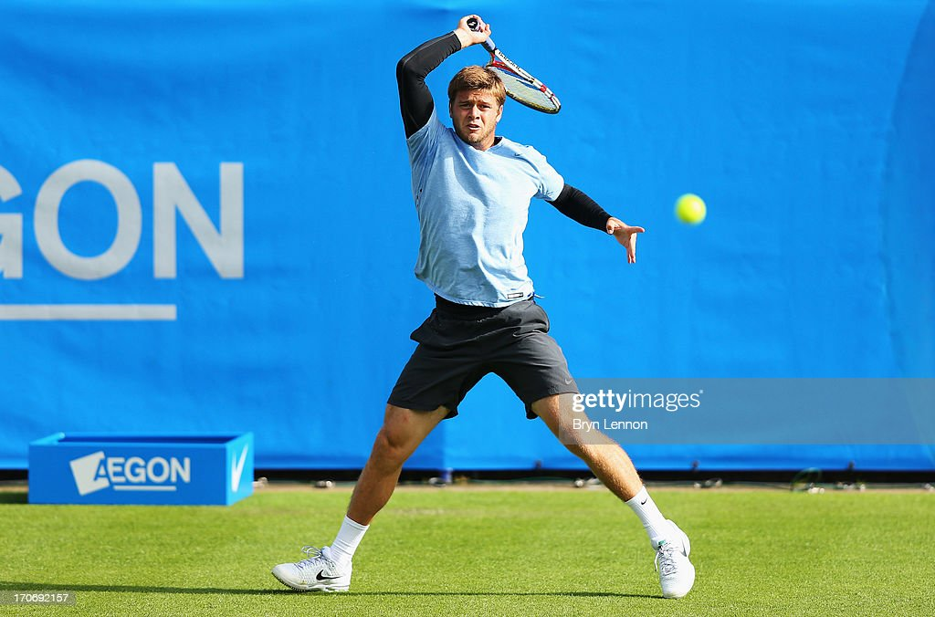 Ryan Harrison of USA returns in his men's singles qualifying match against Michael Russell of USA during day two of the AEGON International tennis tournament at Devonshire Park on June 16, 2013 in Eastbourne, England.