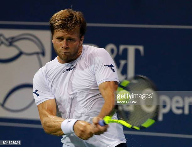 Ryan Harrison returns a backhand to Kyle Edmund of Great Britain during the BBT Atlanta Open at Atlantic Station on July 29 2017 in Atlanta Georgia