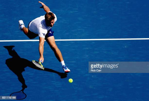 Ryan Harrison tries to return a shot by Gilles Muller of Luxembourg during the Western Southern Open on August 13 2017 in Mason Ohio