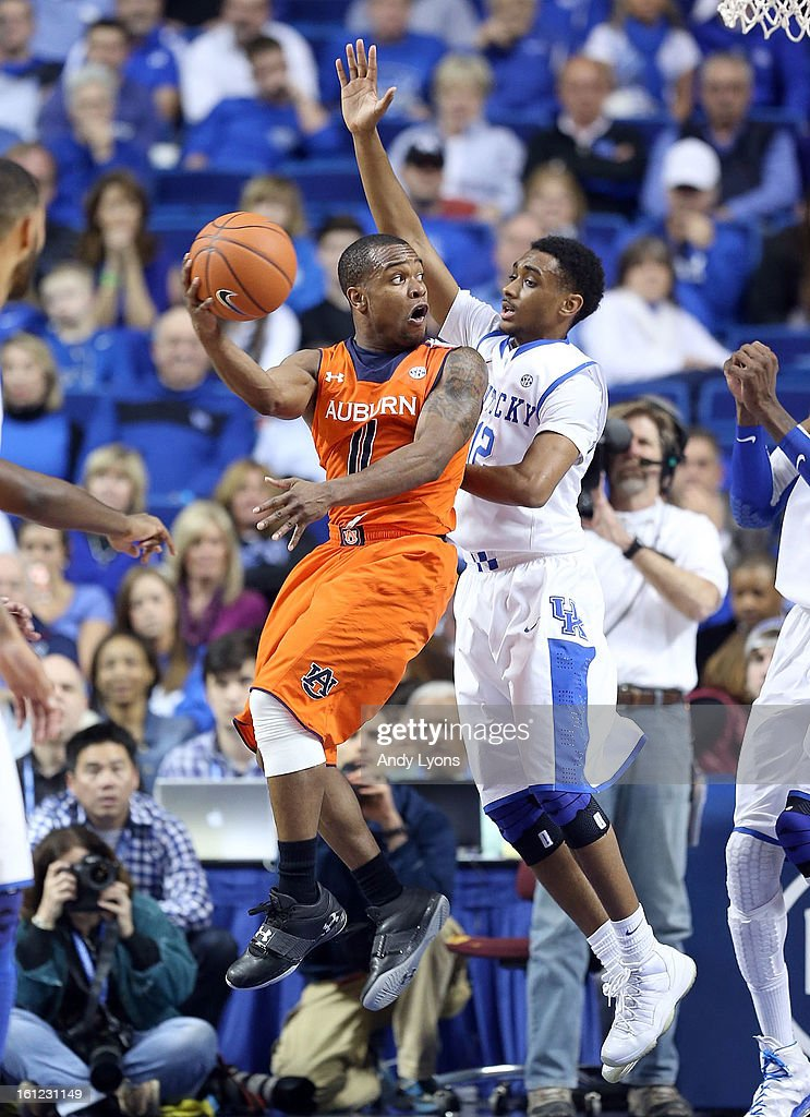 Ryan Harrow #12 of the Kentucky Wildcats defends the shot of Josh Wallace #11 of the Auburn Tigers at Rupp Arena on February 9, 2013 in Lexington, Kentucky.