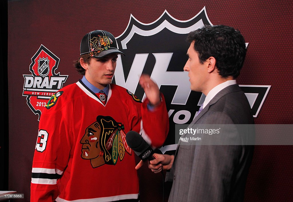 <a gi-track='captionPersonalityLinkClicked' href=/galleries/search?phrase=Ryan+Hartman&family=editorial&specificpeople=9156569 ng-click='$event.stopPropagation()'>Ryan Hartman</a>, 30th overall pick by the Chicago Blackhawks, speaks with Steve Mears of the NHL Network during the 2013 NHL Draft at Prudential Center on June 30, 2013 in Newark, New Jersey.