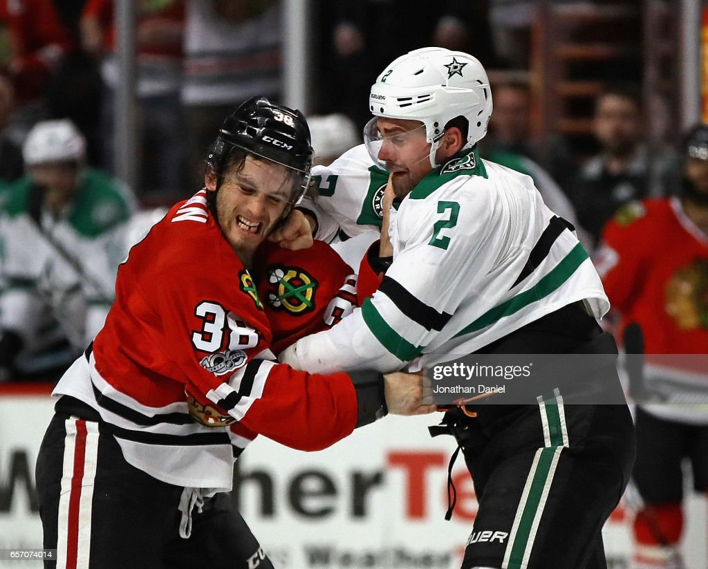 Ryan Hartman #38 of the Chicago Blackhawks and Dan Hamhuis #2 of the Dallas Stars fight in the second period at the United Center on March 23, 2017 in Chicago, Illinois.
